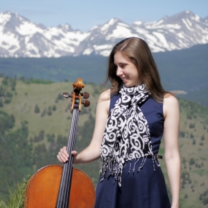 Greta with her cello in the mountains